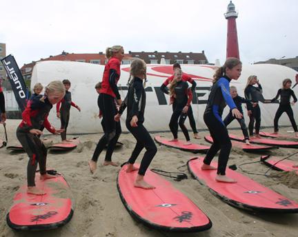 Sierra Partridge teaching surfing in Holland