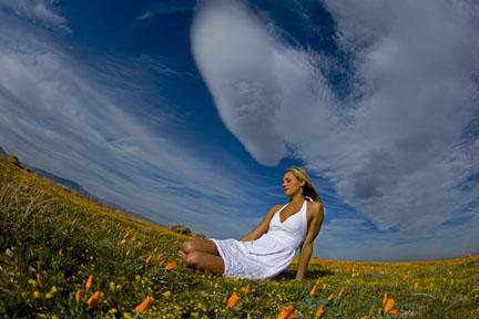 Hailey Partridge in a poppy field