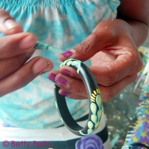 Nyoman's beautiful hands add a layer of design to one of the Hobie Bohemian Bangles. Each one is painted by hand by the Balinese Artisans of Betty B. for the Hobie Project.