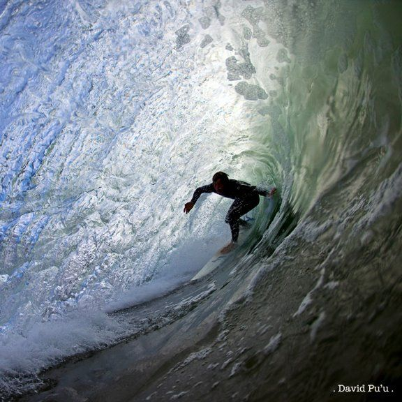 Surfer in the barrel by David Pu'u