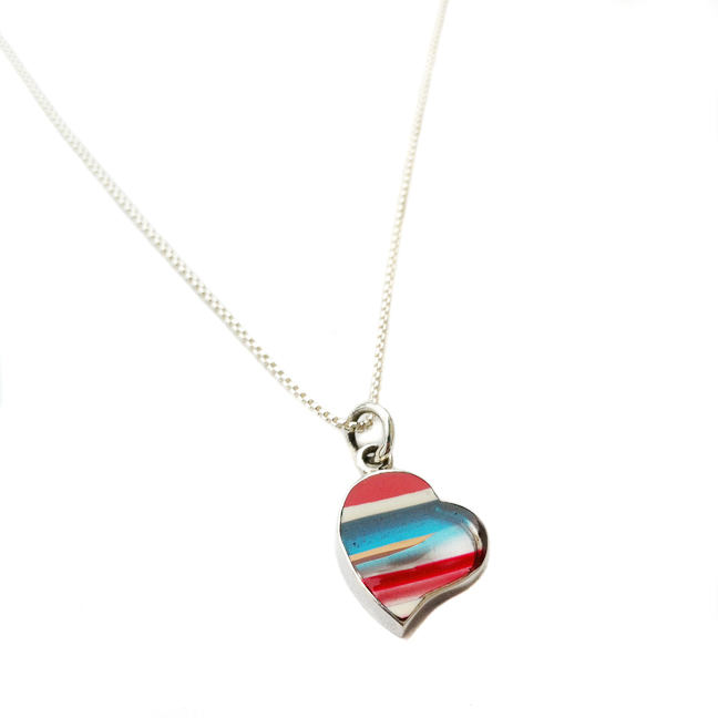 Upcycled surfboard resin charm necklace in sterling.